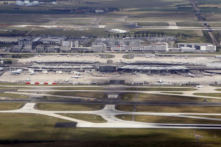 FILE - This June 23, 2011 aerial file photo shows Roissy Charles De Gaulle hub 2, north of Paris. French opposition lawmakers from the right and the left are joining efforts to try to block the government's plan to privatize Paris airports. (AP Photo/Francois Mori, File)