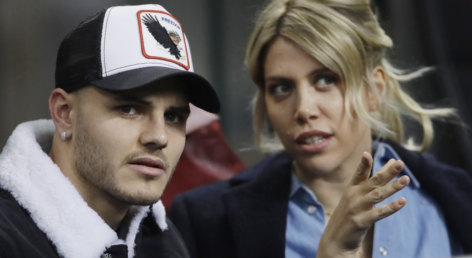 Inter Milan's Mauro Icardi is flanked by his wife Wanda Nara during the Europa League, round of 32, second leg soccer match between Inter Milan and SK Rapid Vienna, at the San Siro stadium in Milan, Italy, Thursday, Feb. 21, 2019. (AP Photo/Luca Bruno)
