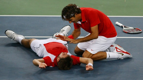 BEIJING - AUGUST 16:  Roger Federer (right) and Stanislas Wawrinka of Switzerland celebrate after defeating Thomas Johansson and Simon Aspelin of Sweden during the men's doubles gold medal tennis match at the Olympic Green Tennis Center on Day 8 of the Beijing 2008 Olympic Games on August 16, 2008 in Beijing, China.  (Photo by Julian Finney/Getty Images)