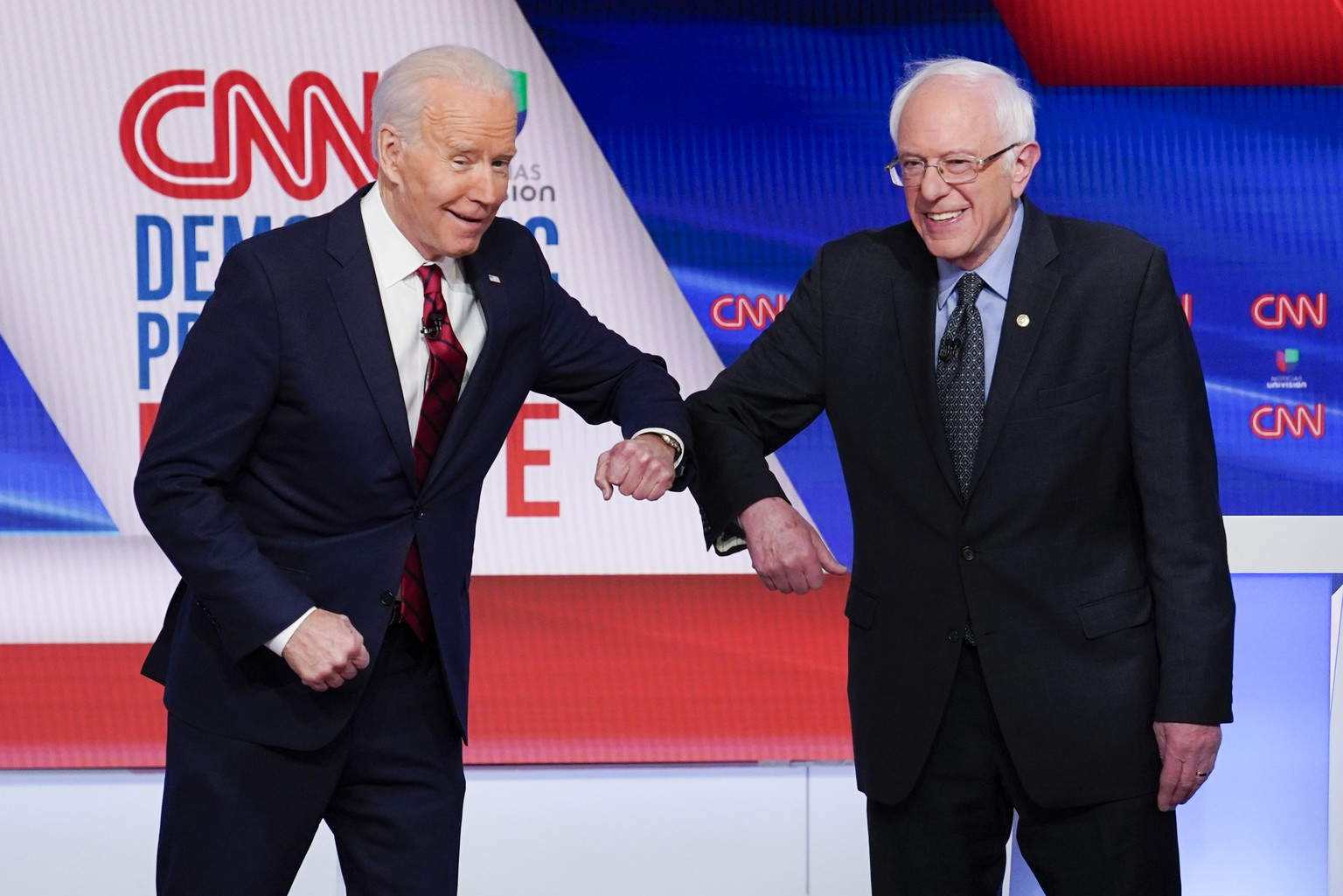 Former Vice President Joe Biden, left, and Sen. Bernie Sanders, I-Vt., right, greet each other before they participate in a Democratic presidential primary debate at CNN Studios in Washington, Sunday, March 15, 2020. (AP Photo/Evan Vucci) Joe Biden,Bernie Sanders