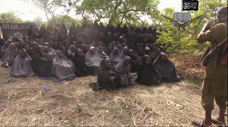 FILE - This file photo taken from video by Nigeria's Boko Haram terrorist network, Monday, May 12, 2014, shows the missing girls alleged to be abducted April 14, from the northeastern town of Chibok. A Nigerian government official said