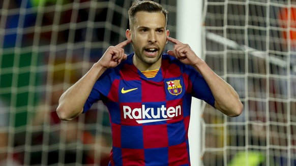 Barcelona's Jordi Alba celebrates before the goal he scored was disallowed after a VAR decision during a Spanish La Liga soccer match between Barcelona and Real Sociedad at the Camp Nou stadium in Barcelona, Spain, Saturday, March 7, 2020. (AP Photo/Joan Monfort)