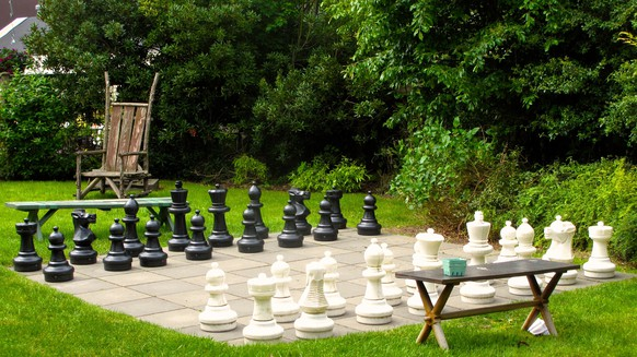 This May 25, 2013 photo taken in the backyard of a property near Langley, Wash., shows an outdoor chess set that provides as much satisfaction as utility. It also may pay off when selling the property. Wellness in landscape design is all about adding more value to the property — emotional as well as financial. (Dean Fosdick via AP)