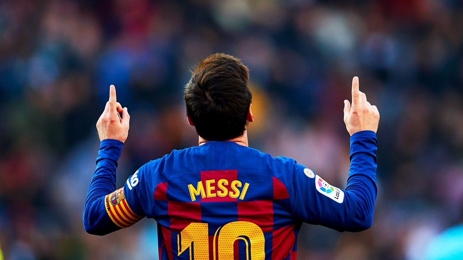 epa08237931 FC Barcelona's Argentinian striker Lionel Messi celebrates after scoring the 2-0 lead during the Spanish La Liga soccer match between FC Barcelona and SD Eibar at Camp Nou in Barcelona, Spain, 22 February 2020.  EPA/ALEJANDRO GARCIA