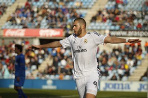 Real's Karim Benzema celebrates his goal during a Spanish La Liga soccer match between Real Madrid and Getafe at the Coliseum Alfonso Perez stadium in Madrid, Spain, Sunday, Feb. 16, 2014. (AP Photo/Gabriel Pecot)