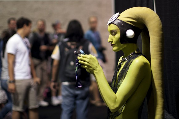 A woman in costume checks her phone at the Star Wars Celebration convention in Anaheim, California, April 16, 2015. The Star Wars Celebration runs through April 19 at the Anaheim Convention Center.  REUTERS/David McNew