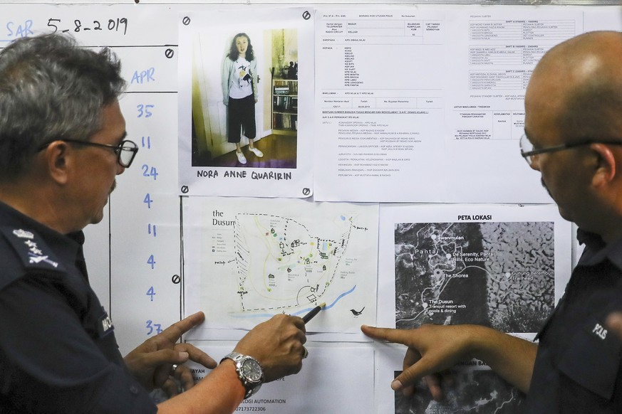 epa07758763 Negeri Sembilan Police Chief Mohamad Mat Yusop (L) shows 'The Dusun' map during a press conference, in Seremban, Negeri Sembilan, Malaysia, 06 August 2019 relating to the disapearence of 15-year-old Nora Quoirin from London who went missing in Seremban. The Lucie Blackman Trust state on 05 August 2019 that the family of missing 15-year old London schoolgirl, Nora Quoirin, appealed for help in locating her. Nora, who has special needs, is the daughter of an Irish-French couple. NÃ3ra disappeared while on a holiday with her family at 'The Dusun' resort in a nature reserve near Seremban, 63 km south of Kuala Lumpur, Malaysia. Her father raised the alarm when he discovered her missing from her bedroom on 04 August 2019. Her window had been opened.  EPA/FAZRY ISMAIL