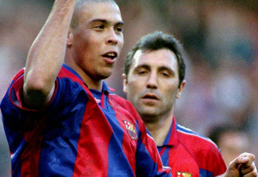Barcelona's 20 year old Brazilian striker Ronaldo celebrates a goal he just scored against Compostela at Barcelona's Nou Camp stadium Sunday March 9, 1997. Barcelona won the game 3-0. Player on right is Bulgarian team-mate Hristo Stoichkov (AP Photo/Cesar Rangel)