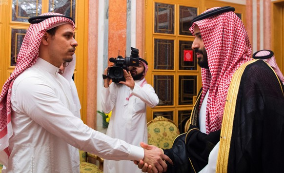 In this photo released by Saudi Press Agency, SPA, Saudi Crown Prince Mohammed bin Salman, right, shakes hands with Salah Khashoggi, a son, of Jamal Khashoggi, in Riyadh, Saudi Arabia, Tuesday, Oct. 23, 2018. Saudi Arabia, which for weeks maintained that Jamal Khashoggi had left the Istanbul consulate, on Saturday acknowledged he was killed there in a