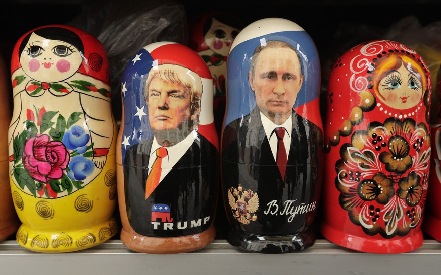 In this Monday, Feb. 20, 2017 traditional Russian wooden dolls called Matryoshka depicting US President Donald Trump, centre left and Russian President Vladimir Putin are displayed for sale at a souvenir street shop in St.Petersburg, Russia.The Kremlin refrained from comment Tuesday, Feb. 21, 2017 on the appointment of the new U.S. national security adviser Army Lt. Gen. H.R. McMaster, but one lawmaker said he was likely to take a hawkish stance toward Russia. (AP Photo/Dmitri Lovetsky)