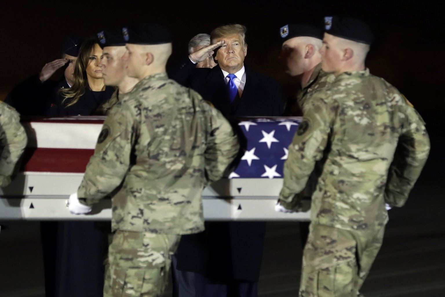 President Donald Trump and first lady Melania Trump watch as a U.S. Army carry team moves a transfer case containing the remains of Chief Warrant Officer 2 David C. Knadle, of Tarrant, Texas, Thursday, Nov. 21, 2019, at Dover Air Force Base, Del. According to the Department of Defense, Knadle died in Afghanistan when his helicopter crashed while providing security for troops on the ground in eastern Logar Province. (AP Photo/ Evan Vucci) Donald Trump