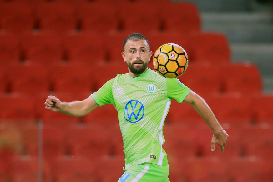 Wolfsburg's Admir Mehmedi controls the ball during the second qualifying round soccer match of Europa League between Kukes and Wolfsburg at Arena Kombetare in Tirana, Albania, Thursday, Sept 17, 2020. (AP Photo/Hektor Pustina)