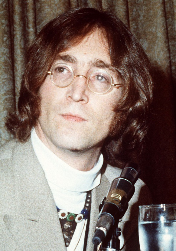This undated file photo shows John Lennon. It's hard to imagine which event sounds more implausible: John Lennon's 70th birthday, Saturday Oct. 9, 1940; or the 30th anniversary of his murder - Dec. 8, 1980. (AP Photo, file)