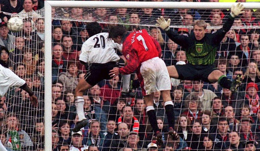 PAP11-19980221-MANCHESTER, UNITED KINGDOM: Manchester United goalkeeper Peter Schmeichel (R) saves a shot from Derby's Stefano Eranio (L) during the Premiership match at Old Trafford, 21 February. Manchester United defeated Derby 2-0.  (Other player not identified.)  EPA PHOTO/PA/John Giles/STF/drm-hh   == UK OUT ==