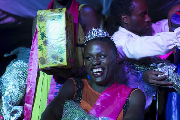 "Mahad, who identifies as a trans-woman, smiles moments after being crowned as the winner of the Miss Pride beauty contest at an undisclosed venue in Kampala, Uganda, August 7, 2015. ""I will travel around the country to educate Ugandans about our rights,� Mahad said. She's now tasked with being the face of the LGBTI community in Uganda. Homosexuality is taboo in almost all African countries and illegal in most including Uganda, where rights groups say gay people have long risked jail. Fear of violence, imprisonment and loss of jobs means few gays in Africa come out. On Saturday August 8 members of the lesbian, gay, bisexual and transgender (LGBT) community emerge from the shadows as they celebrate Gay Pride near the capital Kampala. REUTERS/Edward Echwalu PICTURE 30 OF 30 FOR WIDER IMAGE STORY"