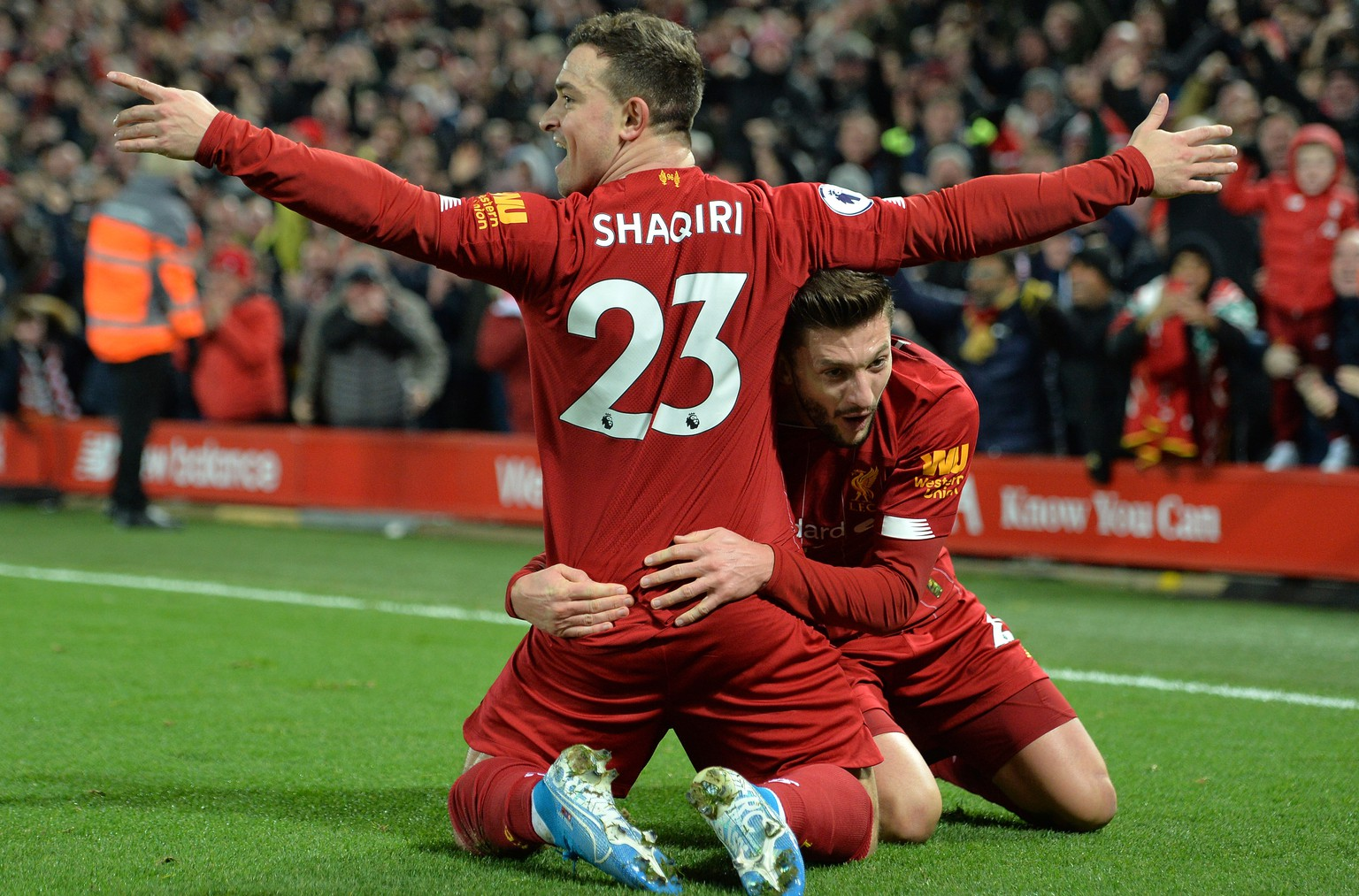 epa08044994 Xherdan Shaqiri (L) of Liverpool celebrates with teammate Adam Lallana after scoring the 2-0 during the English Premier League soccer match between Liverpool FC and Everton in Liverpool, Britain, 04 December 2019.  EPA/Peter Powell EDITORIAL USE ONLY. No use with unauthorized audio, video, data, fixture lists, club/league logos or 'live' services. Online in-match use limited to 120 images, no video emulation. No use in betting, games or single club/league/player publications