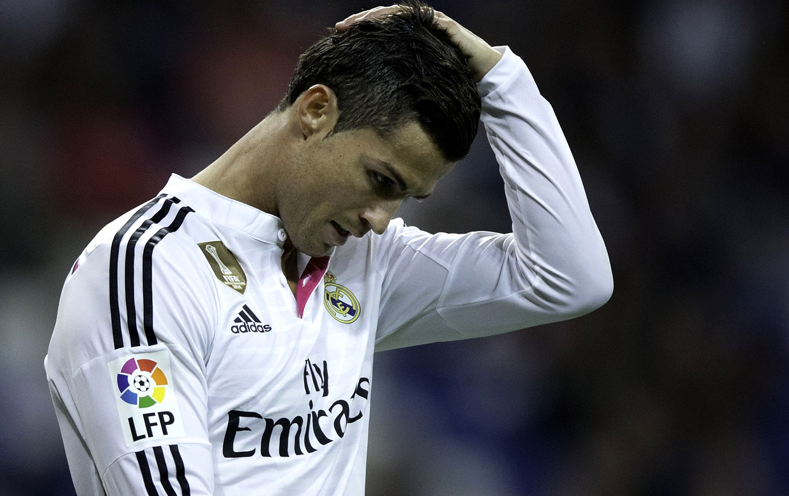 MADRID, SPAIN - APRIL 29:  Cristiano Ronaldo of Real Madrid CF reacts defeated as he leaves the pitch after the La Liga match between Real Madrid CF and UD Almeria at Estadio Santiago Bernabeu on April 29, 2015 in Madrid, Spain.  (Photo by Gonzalo Arroyo Moreno/Getty Images)