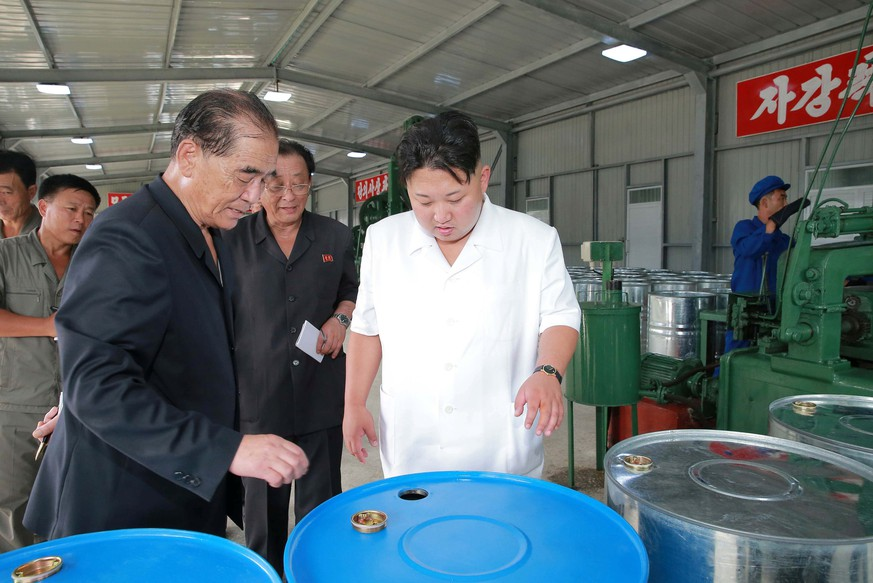 North Korean leader Kim Jong Un looks at the production of acrylic paints during a visit to the Sunchon Chemical Complex in this undated photo released by North Korea's Korean Central News Agency (KCNA) in Pyongyang on August 13, 2016. KCNA/ via REUTERS  ATTENTION EDITORS - THIS IMAGE WAS PROVIDED BY A THIRD PARTY. EDITORIAL USE ONLY. REUTERS IS UNABLE TO INDEPENDENTLY VERIFY THIS IMAGE. NO THIRD PARTY SALES. SOUTH KOREA OUT. NO COMMERCIAL OR EDITORIAL SALES IN SOUTH KOREA.