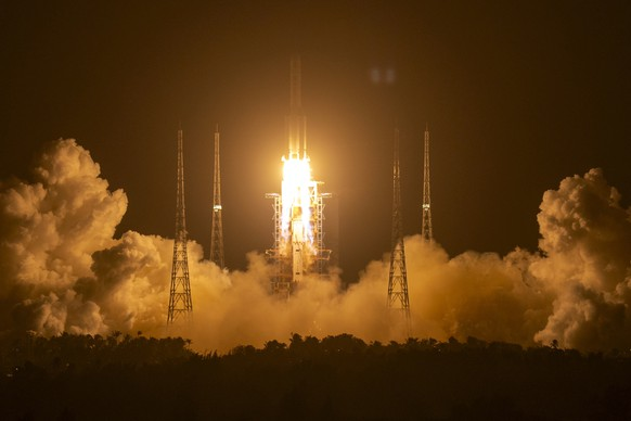 A Long March-5 rocket carrying the Chang'e 5 lunar mission lifts off at the Wenchang Space Launch Center in Wenchang in southern China's Hainan province, early Tuesday, Nov. 24, 2020. China's trip to the moon and, presumably, back is the latest milestone in the Asian powerhouse's slow but steady ascent to the stars. (AP Photo/Mark Schiefelbein, File)