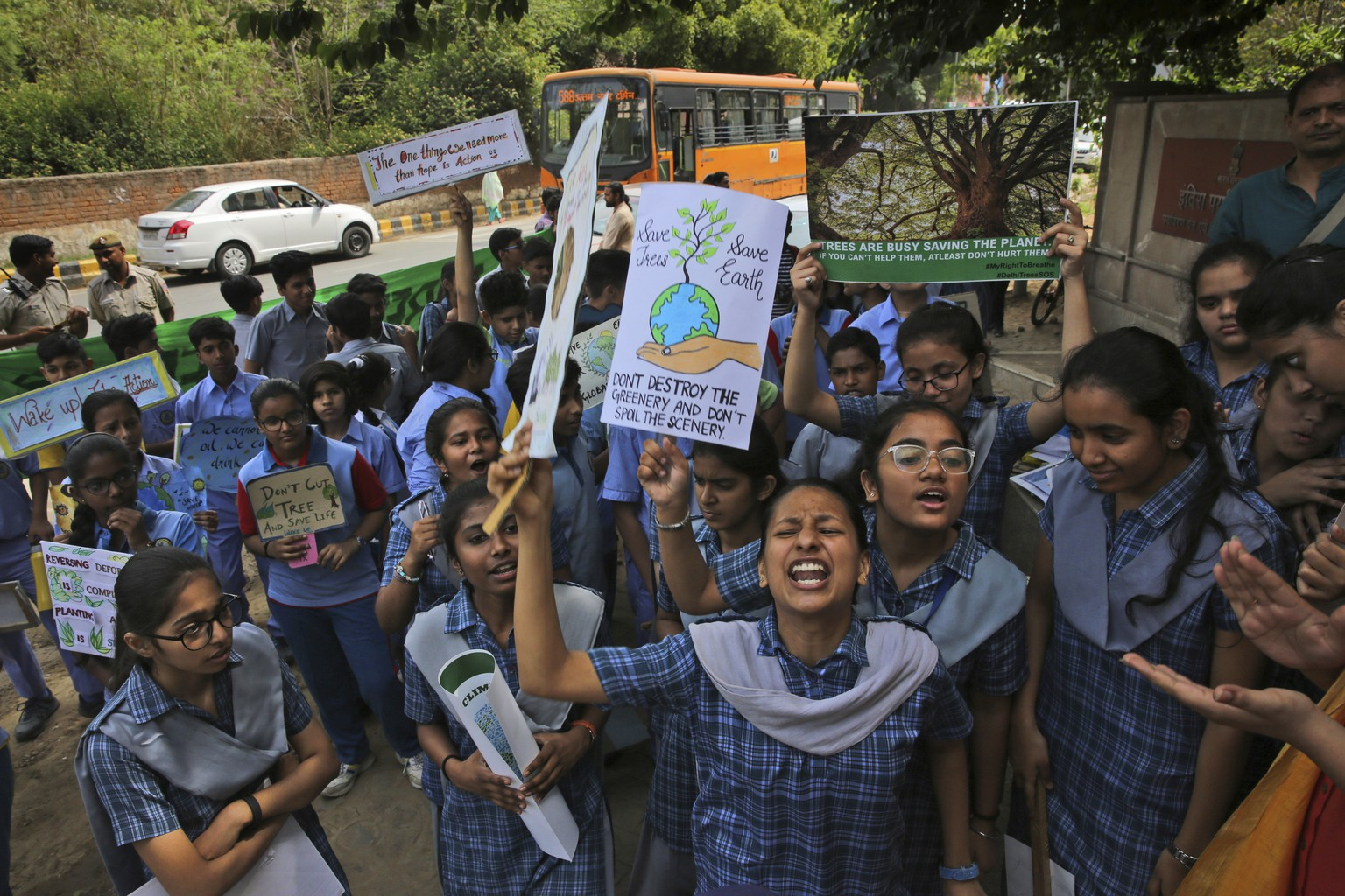 Students from different schools voice their concerns outside Indian Ministry of Environment, Forest and Climate Change during a protest in New Delhi, India, Friday, April 12, 2019. Students in more than 80 countries and territories worldwide plan to skip class Friday in protest over their governments' failure to act against climate change. The coordinated 'school strike' was inspired by 16-year-old activist Greta Thunberg, who began holding solitary demonstrations outside the Swedish parliament last year. (AP Photo/Manish Swarup)