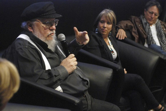 FILE - In this Oct. 19, 2017, file photo, author and film producer, George R. R. Martin, left, speaks in Santa Fe, N.M. Martin, the famed author of the