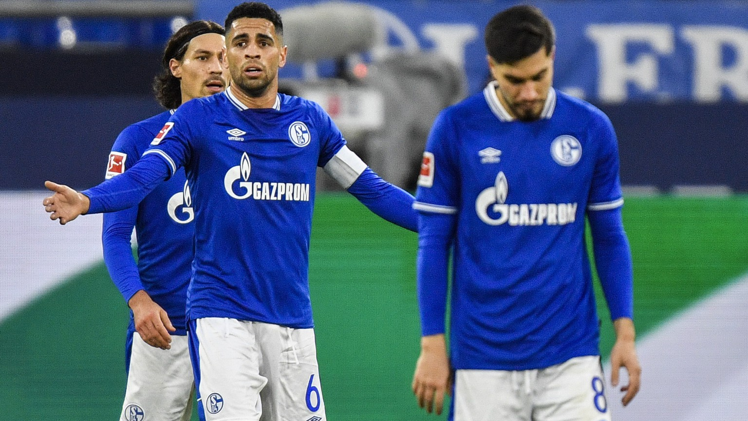 Schalke's Omar Mascarell, center, reacts during the German Bundesliga soccer match between VfL Wolfsburg and FC Schalke 04 at the Veltins-Arena in Gelsenkirchen, Germany, Saturday, Nov. 21, 2020. (AP Photo/Martin Meissner, Pool)