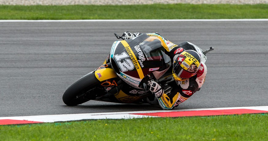 epa05477179 Swiss Moto2 rider Thomas Luethi of Garage Plus Interwetten Team in action during the second free training for the Motorcycle World Championship Grand Prix Austria at the Spielberg Ring in Spielberg, Austria, 12 August 2016.  EPA/CHRISTIAN BRUNA