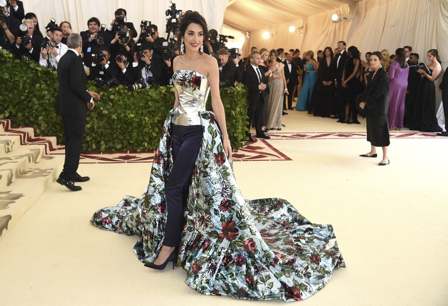 Amal Clooney attends The Metropolitan Museum of Art's Costume Institute benefit gala celebrating the opening of the Heavenly Bodies: Fashion and the Catholic Imagination exhibition on Monday, May 7, 2018, in New York. (Photo by Evan Agostini/Invision/AP)