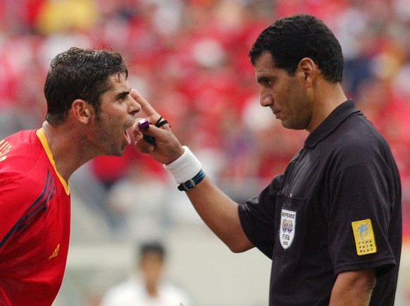 Spain's captain Fernando Hierro has word with Egyptian referee Gamal Ghandour during the quarterfinal match of the 2002 World Cup soccer match between South Korea and Spain at the Gwangju World Cup Stadium in Gwanju, South Korea, Saturday, June 22, 2002. (AP Photo/Armando Franca)