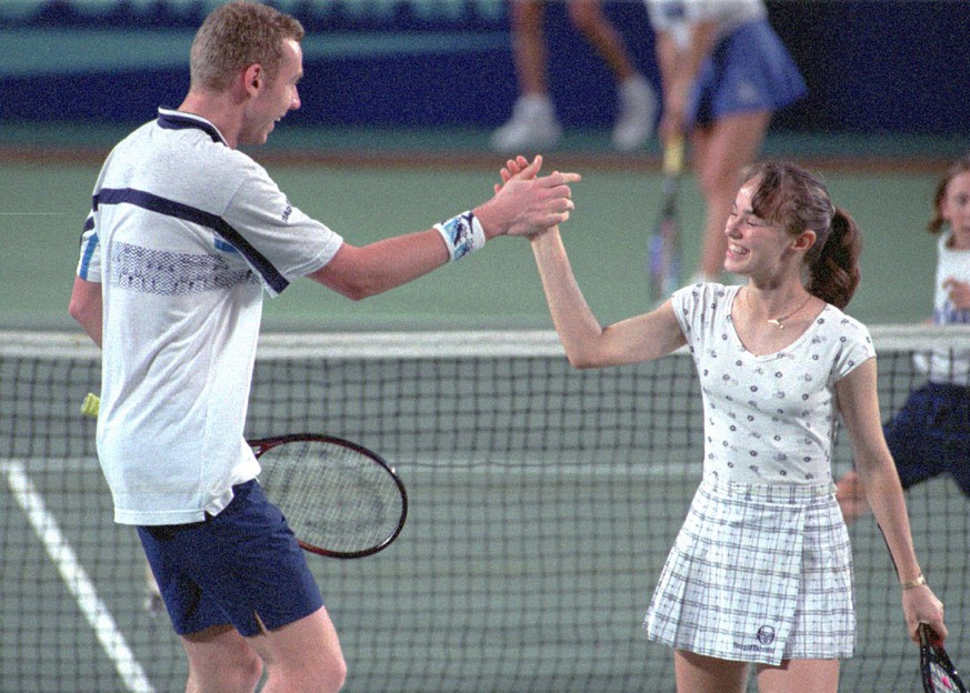 Swiss teammates Marc Rosset and Martina Hingis celebrate after winning a point during their mixed double match against the German team of Anke Huber and Martin Sinner at the Hopman Cup in Perth, Australia Friday January 5, 1996. Switzerland won the match 6-1 6-3 and the round, ensuring themselves a place in the final against Croatia. (AP Photo/ Mogens Johansen)