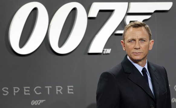 FILE - This is a Wednesday, Oct. 28, 2015 file photo of actor Daniel Craig poses for the media as he arrives for the German premiere of the James Bond movie 'Spectre' in Berlin, Germany. The release of the James Bond film â??No Time To Dieâ? has been pushed back several months because of global concerns about coronavirus. MGM, Universal and producers Michael G. Wilson and Barbara Broccoli announced on Twitter Wednesday that the film would be pushed back from its April release to November 2020.  (AP Photo/Michael Sohn/File)