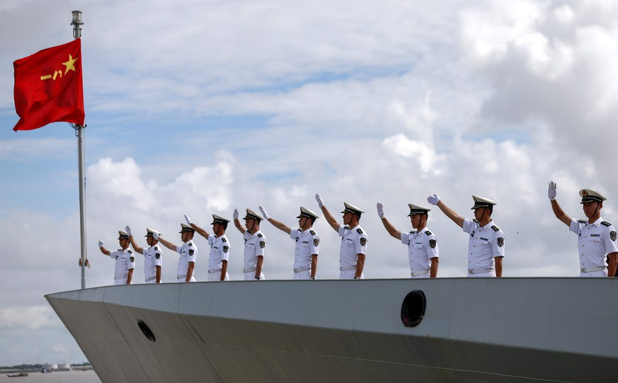 epa05569692 Chinese Navy officers wave hands from deck of Chinese Navy frigate 'FFG Xiangtan' as they departs Myanmar International Terminals at the Thilawa port of Yangon, Myanmar, 04 October 2016. Two Navy frigates, the FFG Xiangtan and the FFG Zhoushan, of People's Liberation Army (PLA) visited Myanmar from 30 September to 04 October in a show of diplomatic cooperation between the two nations.  EPA/LYNN BO BO