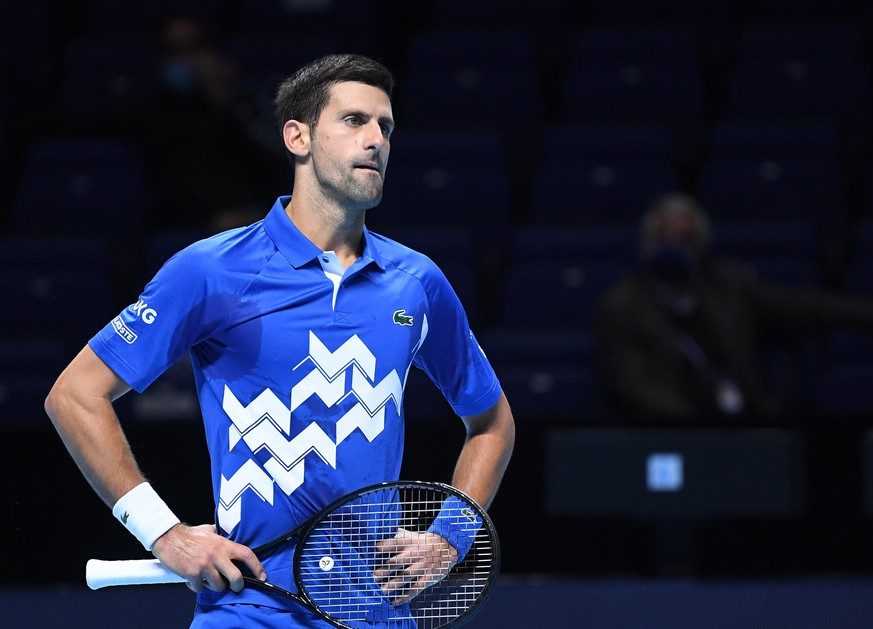 epa08831339 Novak Djokovic of Serbia in action against Alexander Zverev of Germany during their group stage match at the ATP Finals tennis tournament in London, Britain, 20 November 2020.  EPA/ANDY RAIN