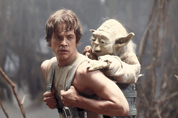 FILE - This image provided by Lucasfilm Ltd. shows Mark Hamill as Luke Skywalker and the character, Yoda, in a scene from the 1980 movie