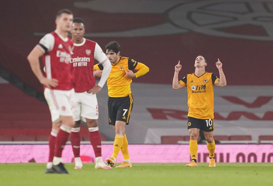 epa08851939 Daniel Podence of Wolverhampton (R) celebrates scoring his team's second goal during the English Premier League soccer match between Arsenal FC and Wolverhampton Wanderers in London, Britain, 29 November 2020.  EPA/John Walton / POOL EDITORIAL USE ONLY. No use with unauthorized audio, video, data, fixture lists, club/league logos or 'live' services. Online in-match use limited to 120 images, no video emulation. No use in betting, games or single club/league/player publications.
