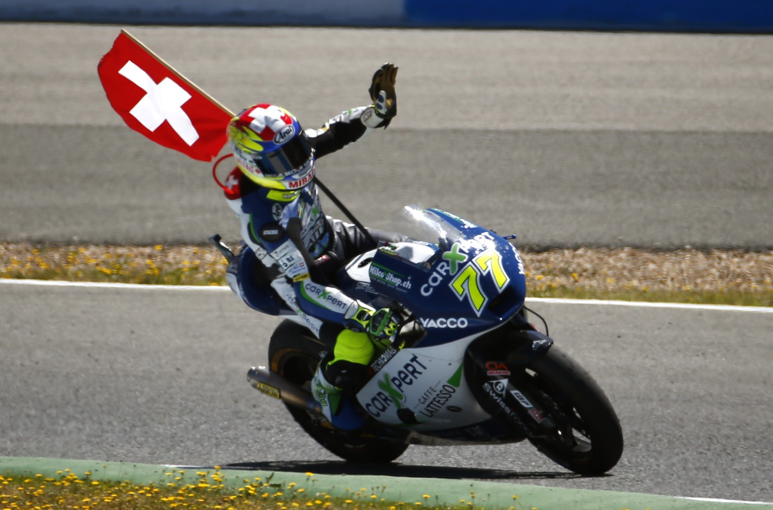 Moto 2 rider Dominique Aegerter of Switzerland waves after finishing in second position at the Spain's Motorcycle Grand Prix at the Jerez race track on Sunday, May 4, 2014 in Jerez de la Frontera, southern Spain. (AP Photo/Miguel Angel Morenatti)