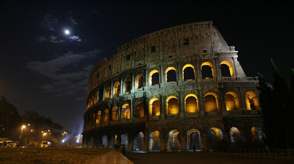 A view of Rome's ancient Colosseum with its lights switched on after a five-minute