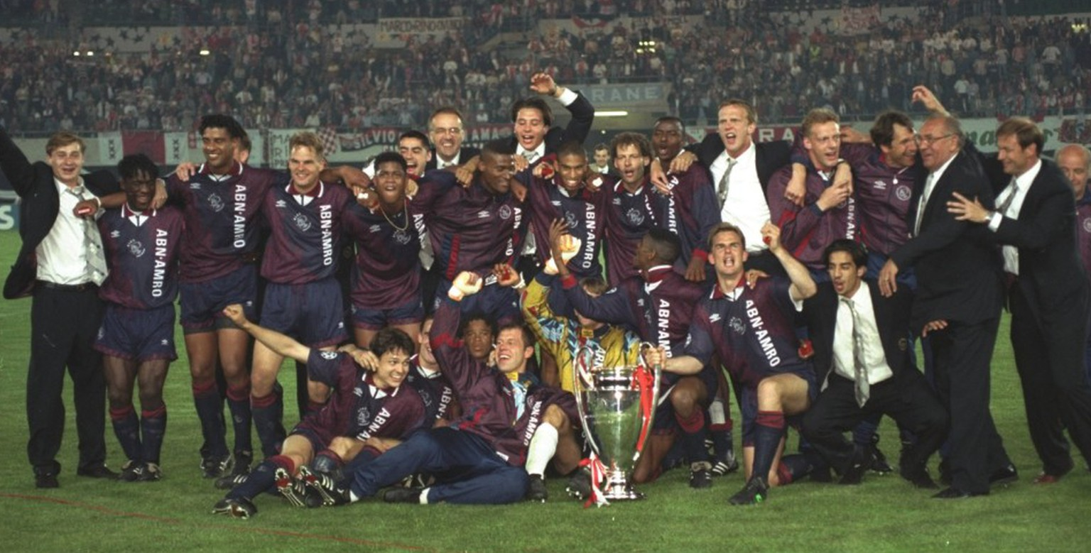 24 May 1995: The Ajax team celebrate with the trophy after their victory in the European Cup Final against AC Milan in Vienna, Austria. Ajax won the match 1-0.  Mandatory Credit: Clive  Brunskill/Allsport