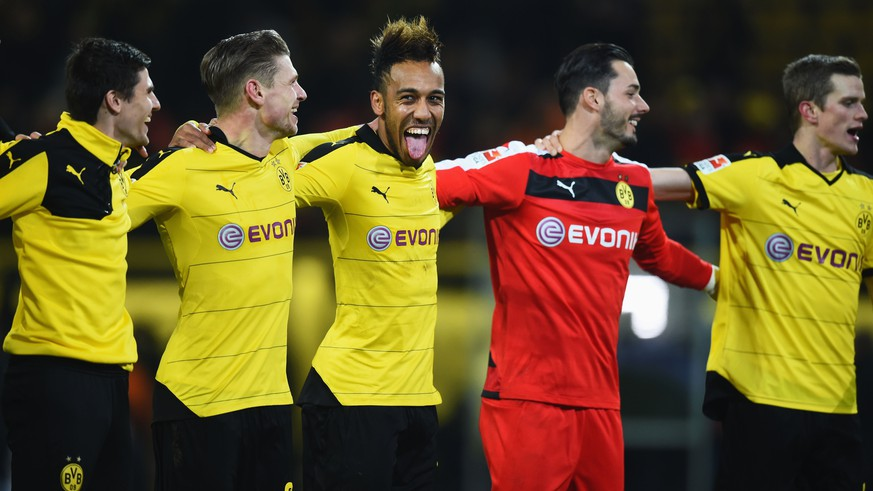 DORTMUND, GERMANY - DECEMBER 13:  Pierre-Emerick Aubameyang of Borussia Dortmund (C) celebrates victory with team mates after the Bundesliga match between Borussia Dortmund and Eintracht Frankfurt at Signal Iduna Park on December 13, 2015 in Dortmund, Germany.  (Photo by Lars Baron/Bongarts/Getty Images)