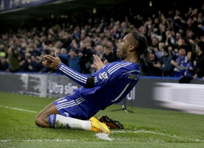 Chelsea's Didier Drogba celebrates scoring his side's second goal during the English Premier League soccer match between Chelsea and Tottenham Hotspur at Stamford Bridge stadium in London, Wednesday, Dec. 3, 2014.  (AP Photo/Matt Dunham)