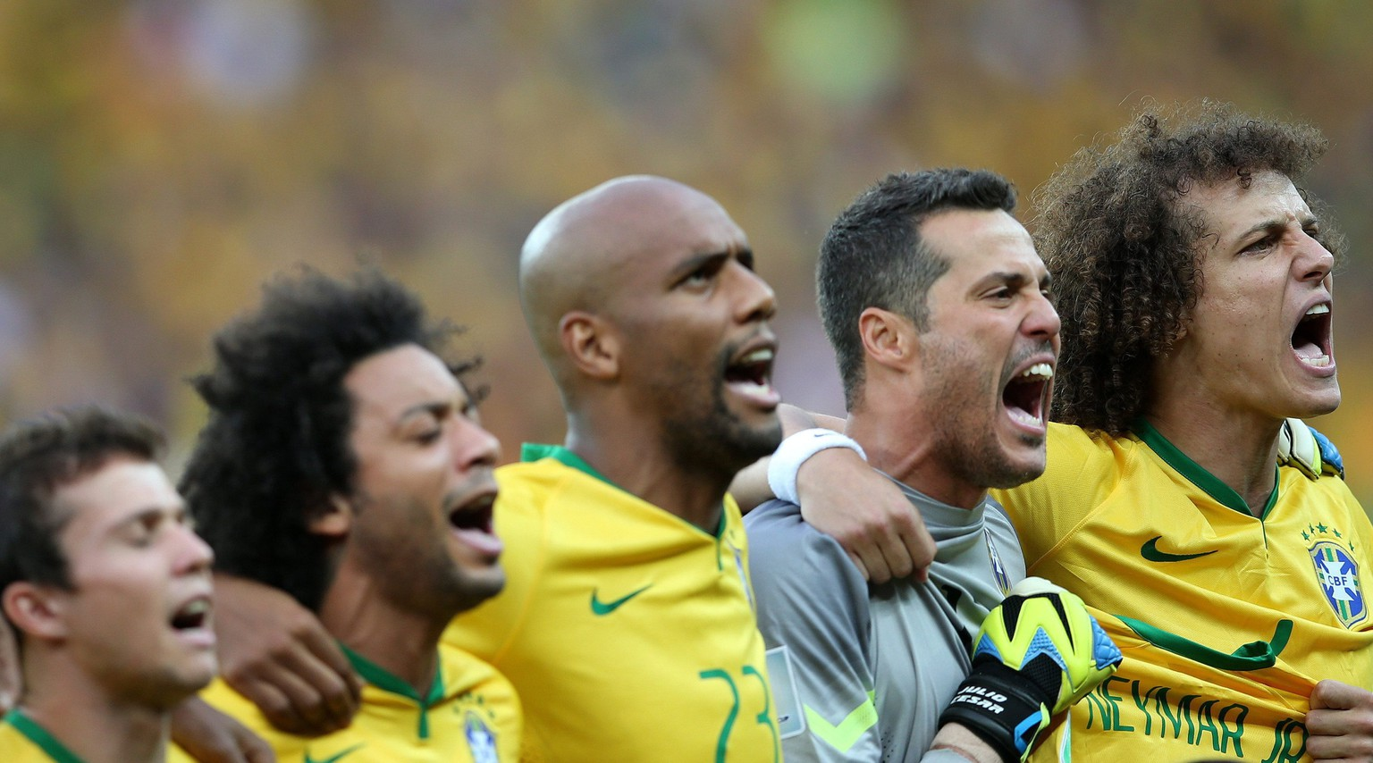 epa04306548 Brazilian players sing the national anthem before the FIFA World Cup 2014 semi final match between Brazil and Germany at the Estadio Mineirao in Belo Horizonte, Brazil, 08 July 2014. 