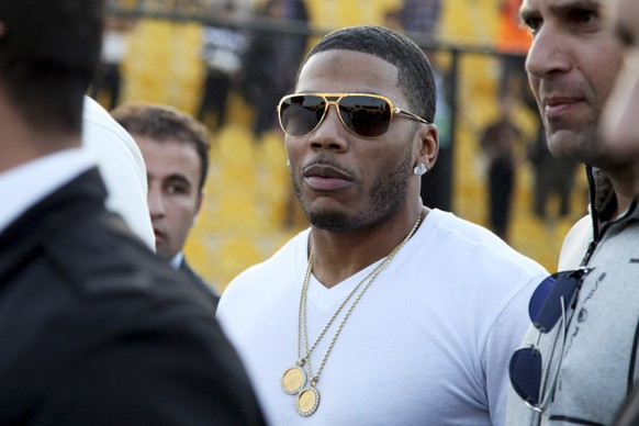 FILE- In March 13, 2015, file photo, rapper Nelly approaches the stage for a concert in Irbil, northern Iraq. Police have arrested Nelly after a woman said he raped her in a town outside Seattle, an accusation the Grammy winner's attorney staunchly denies. Auburn police spokesman Commander Steve Stocker said officers arrested Nelly early Saturday, Oct. 7, 2017, morning in his tour bus at a Walmart.  (AP Photo/Seivan M. Salim, File)