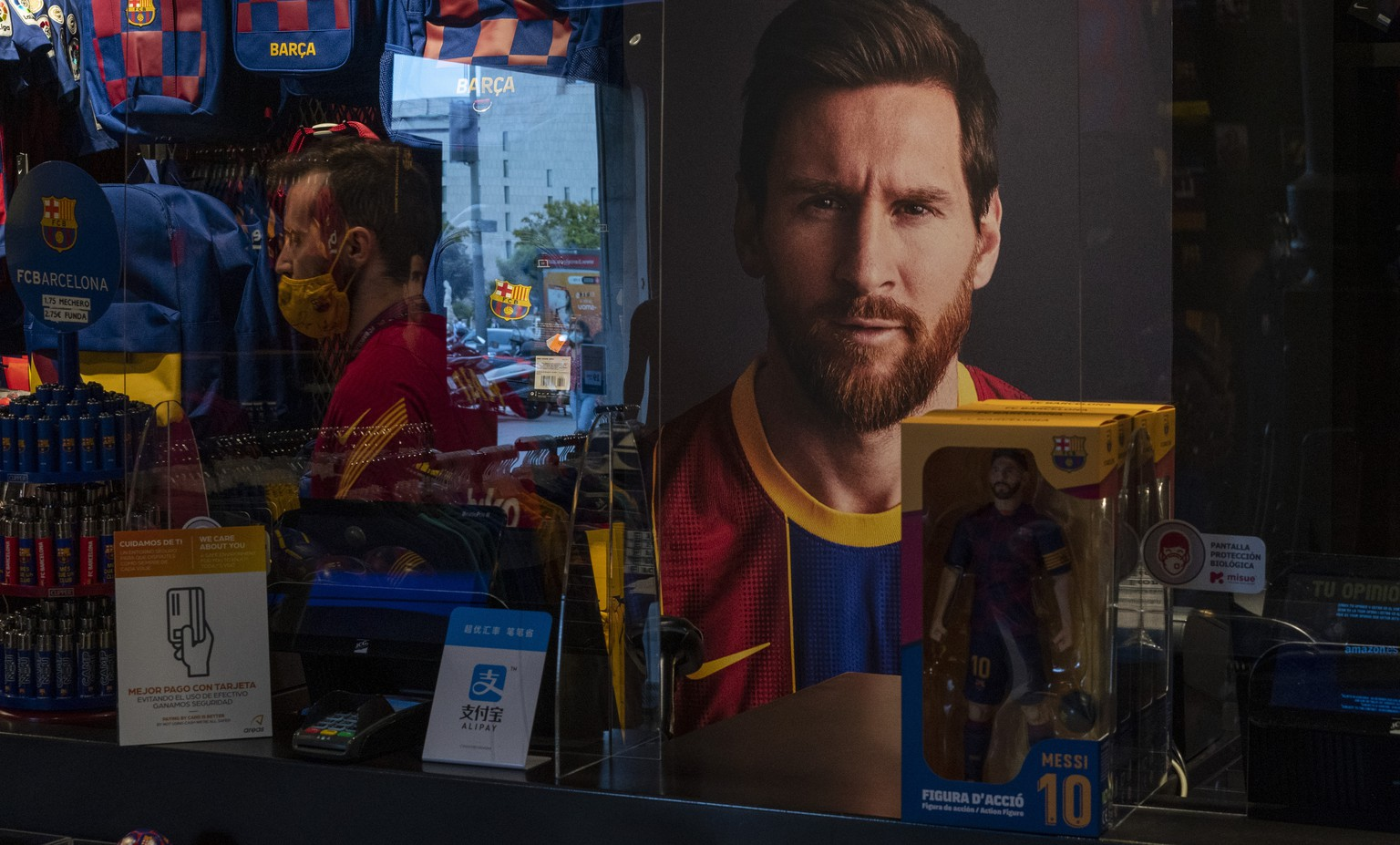 A poster with the face of Barcelona soccer player Lionel Messi is displayed at a F.C. Barcelona store in Barcelona, Spain on Tuesday, Sept. 1, 2020. Barcelona is banking on a face-to-face meeting with Lionel Messi to try to convince him to stay. Talks with Messi