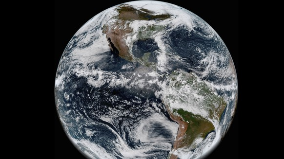 This image provided by NOAA/NASA on Thursday, May 31, 2018 shows the Earth's western hemisphere at 12:00 p.m. EDT on May 20, 2018 made by the new GOES-17 satellite, using the Advanced Baseline Imager (ABI) instrument. The weather satellite observes Earth from about 22,300 miles above the surface. Despite a serious cooling problem, the newest U.S. weather satellite has produced sharp snapshot of Earth. On May 23, 2018, NOAA reported that critical infrared sensors in the satellite's main instrument were not staying cold enough. (NOAA/NASA via AP)