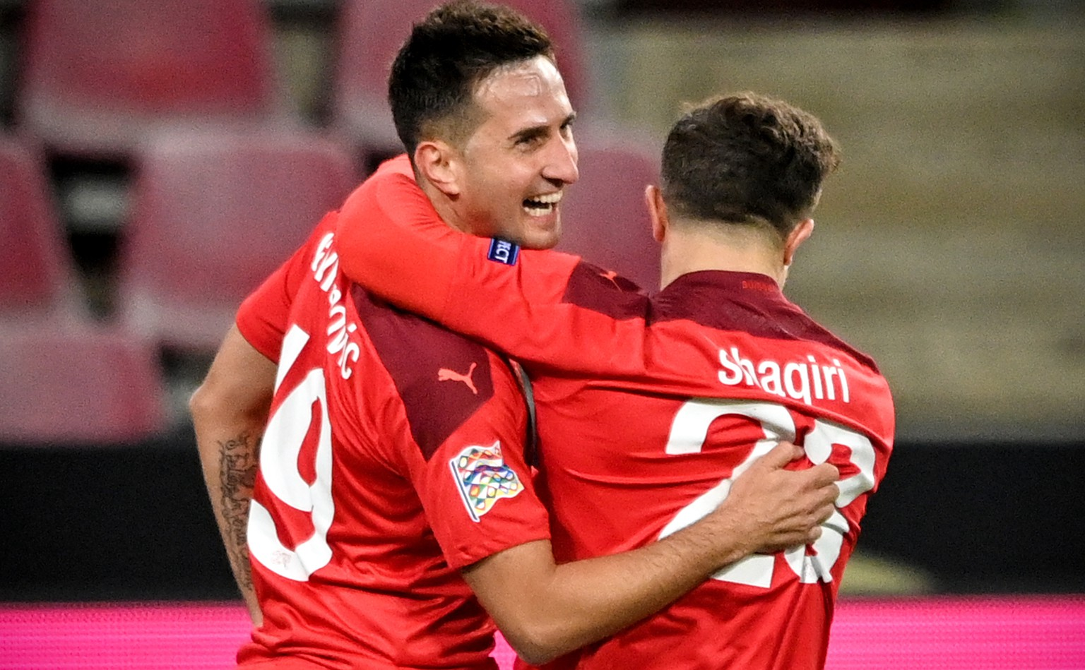 epa08741617 Switzerland's Mario Gavranovic (L) celebrates with his teammate Xherdan Shaqiri (R) after scoring the 1-0 lead during the UEFA Nations League group stage, league A, group 4 soccer match  between Germany and Switzerland in Cologne, Germany, 13 October 2020.  EPA/SASCHA STEINBACH