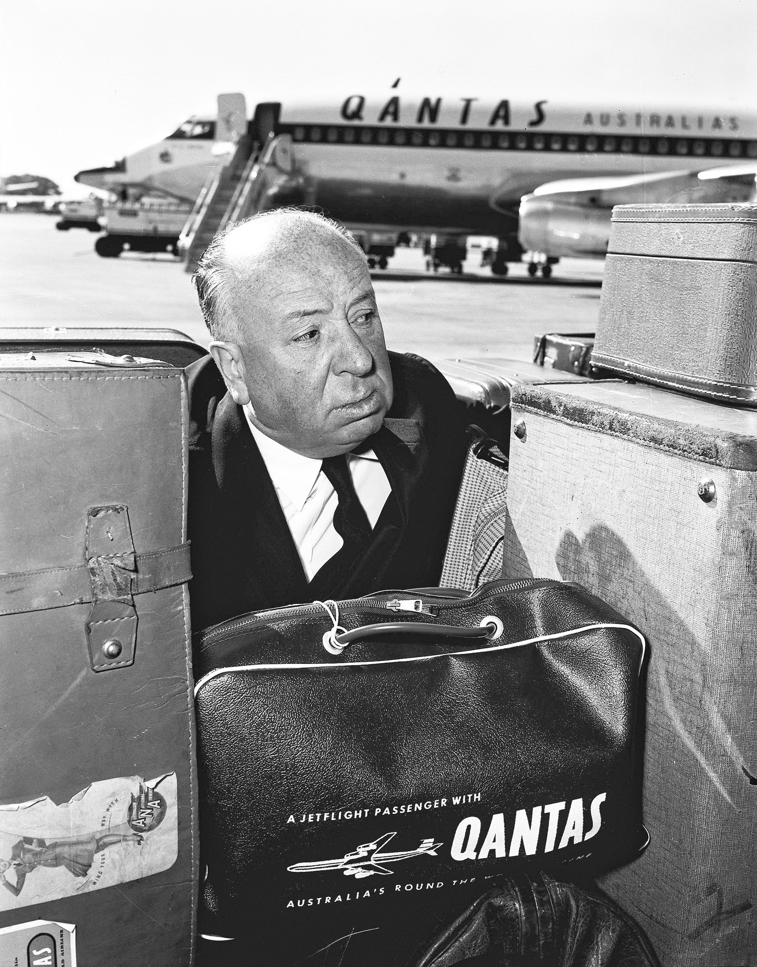 Movie director, Alfred Hitchcock, departs Australia by Qantas at Sydney Airport, 15 May 1960 (Photo by Fairfax Media via Getty Images)