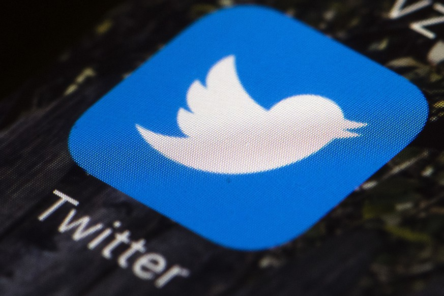FILE - This April 26, 2017, file photo shows the Twitter app icon on a mobile phone in Philadelphia. Twitter says an elected Dutch official was among 36 account holders whose direct message inboxes were accessed by hackers in a recent cyberattack. The politician, anti-Islam lawmaker Geert Wilders, said Thursday, July 23, 2020, he was informed by Twitter that his account was compromised by a hacker, who posted tweets on his account and sent false direct messages in his name. (AP Photo/Matt Rourke, File)
