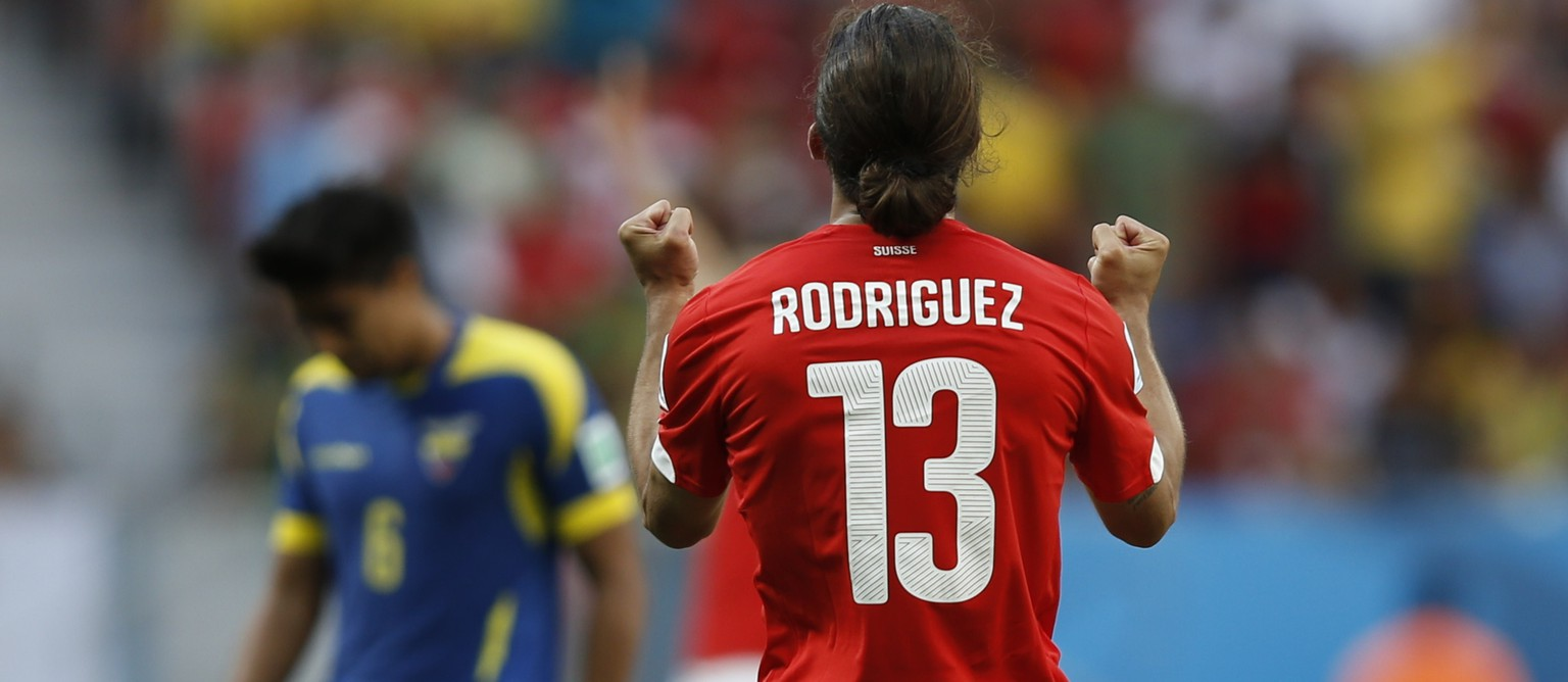 Switzerland's defender Ricardo Rodriguez (R) celebrates after a Group E football match between Switzerland and Ecuador at the Mane Garrincha National Stadium in Brasilia during the 2014 FIFA World Cup on June 15, 2014.  AFP PHOTO / ADRIAN DENNIS
