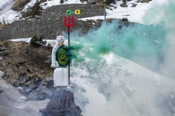The ÒBoeoeggÓ burns on the platform over the Devil's Bridge, on Monday, 19 April 2021, in the Schoellenen Gorge near Andermatt, Switzerland. The Sechselaeuten (ringing of the six o'clock bells) is a traditional end of winter festival with the burning of the Boeoegg, a symbolic snowman, at 6 pm. Because of the coronavirus pandemic, the festival takes place without the parade of guilds in historical uniforms and not on the Sechselaeutenplatz square in Zurich but in the Schoellenen Gorge of the guest canton Uri. (KEYSTONE/Urs Flueeler)
