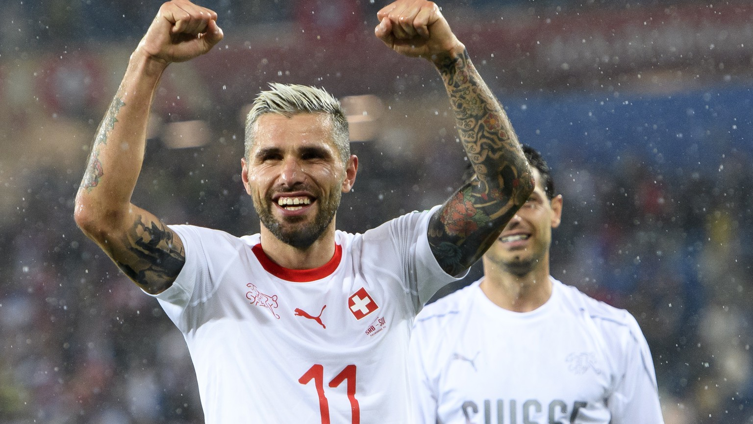 epa06832250 Switzerland's midfielder Valon Behrami celebrates the victory during the FIFA World Cup 2018 group E preliminary round soccer match between Switzerland and Serbia at the Arena Baltika Stadium in Kaliningrad, Russia, 22 June 2018.  EPA/LAURENT GILLIERON